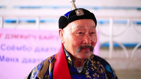ULAANBAATAR, MONGOLIA - JULY 2013: Mongolian man w Stock Video Footage