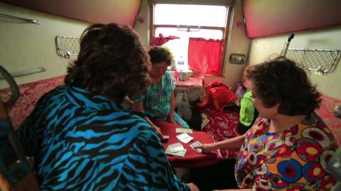 TRANS-SIBERIAN TRAIN, MONGOLIA/RUSSIA : Women play Stock Video Footage
