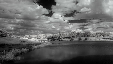 InfraRed landscape: Movement of clouds over the re Footage