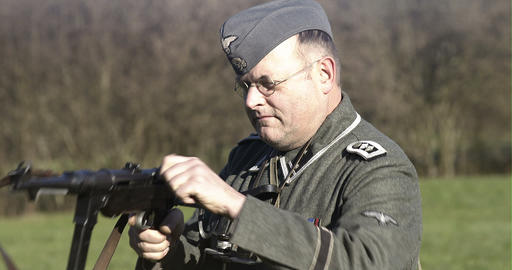 World War 2 German sodlier aiming with MP 40 Stock Video Footage