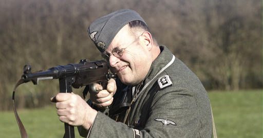World War 2 German sodlier aiming with MP 40 Footage