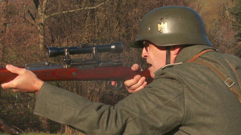 World War 2 German sodlier aiming with sniper rifl Live Action