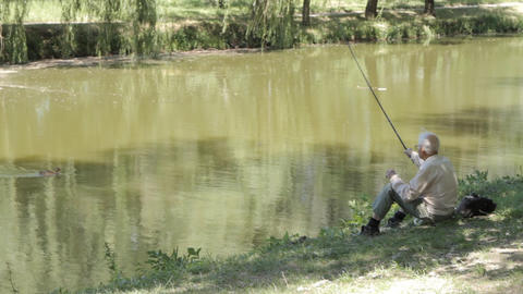Old Man Fishing. Retired elderly people, hobby and Stock Video Footage