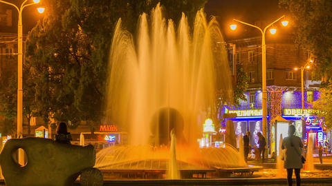 Fountain at Square. City. Night lights. Time lapse Footage