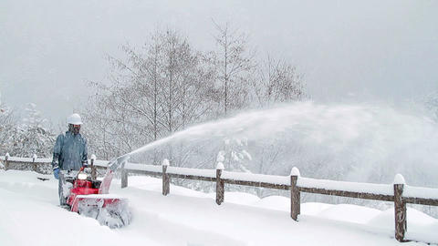 Snow blower removes snow Footage