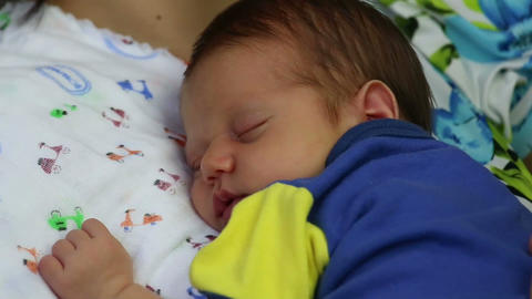 Newborn sleeping in mother arms Footage
