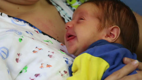 Closeup view face of a newborn baby in the body of Stock Video Footage