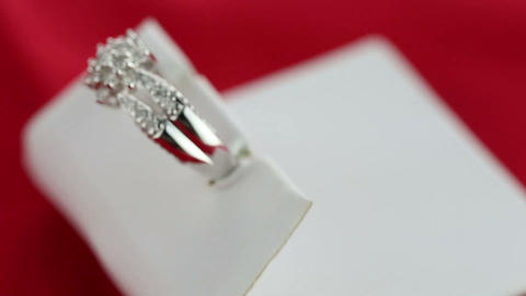 Wedding ring in a white silk Stock Video Footage