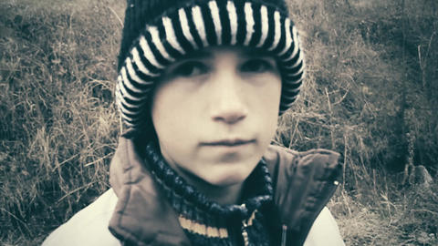 Sad child with winter cap Stock Video Footage