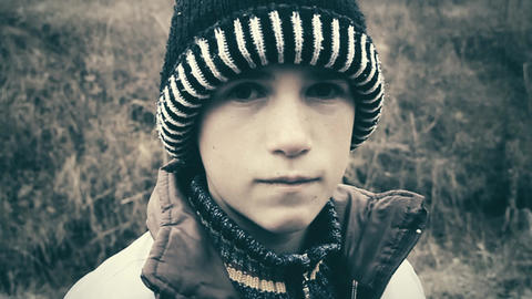 Sad Child With Winter Cap stock footage