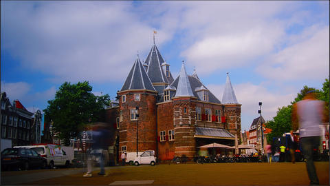 The Waag; rush hour in Amsterdam, tourists walking Stock Video Footage