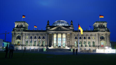 Reichstag with tourists visiting and walking aroun Stock Video Footage