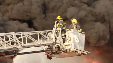 firefighters battle blaze in packaging factory ind Footage