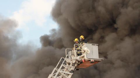 firefighters battle blaze in packaging factory Footage