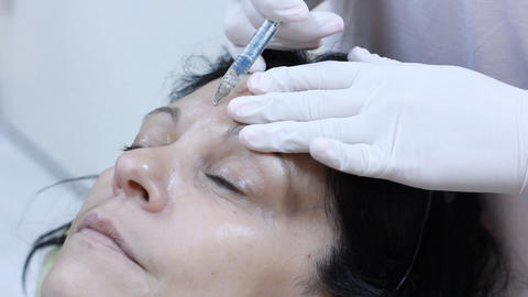 Cosmetic treatment in a clinic woman getting a bot Footage