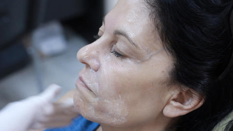 Cosmetic treatment in a clinic woman getting a bot Stock Video Footage