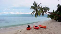 Kayaks on tropical beach Stock Video Footage