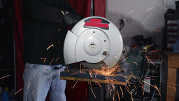 Man cutting steel with saw Stock Video Footage