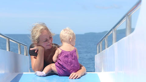 child plays mother on ship Stock Video Footage