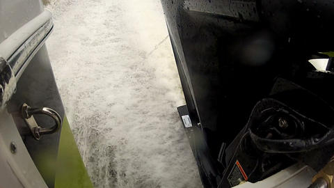 Detail of outboard engine on a boat Live Action