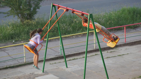 Teenagers swinging on the teeter Footage