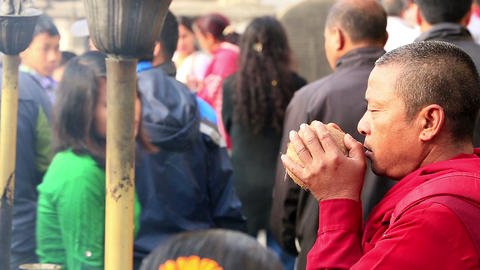 KATHMANDU, NEPAL - APRIL 5, 2014: Мonk praying in Footage