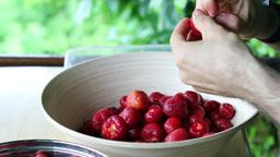 Strawberries. Man prepares strawberries. 1 Stock Video Footage