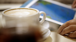 Woman using touch pad during coffee break Footage