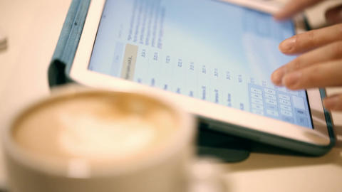 Working with tablet pc and having cup of coffee Stock Video Footage