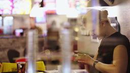 Young woman in cafe thinking over sms and typing i Footage