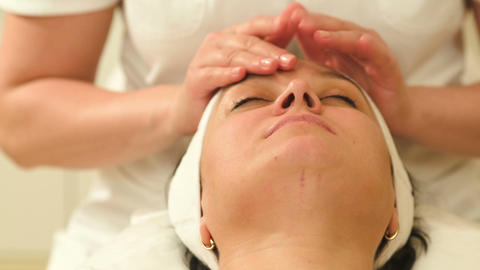 Woman relaxing during facial therapy at beauty spa Footage