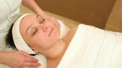 Facial treatment with professional massage of cosm Stock Video Footage
