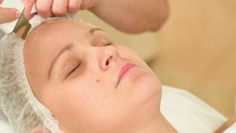 Young woman taking facial treatments of ultrasonic Footage