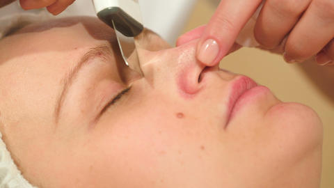 Young woman getting ultrasonic cleaning of a nose Footage