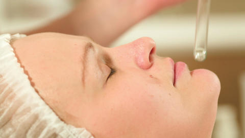 Facial procedure at beauty spa with laser using Live Action