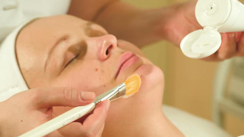 Applying facial mask in beauty treatment salon Footage