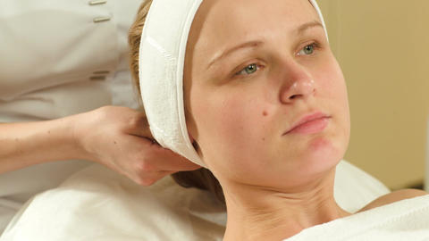 Woman being prepared for facial spa procedures Live Action