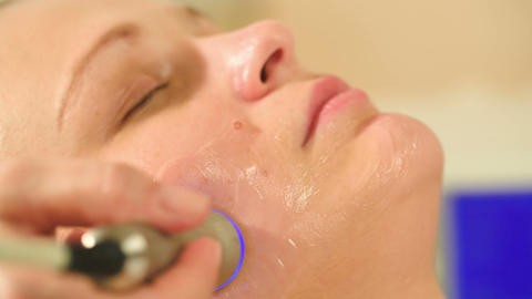 Cosmetician providing lifting procedure with speci Footage