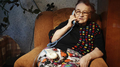 Old Woman Receiving A Phone Call In The Evening stock footage