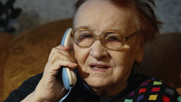 Elderly Woman In Glasses Taking A Call stock footage
