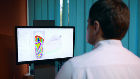 Doctor working with shoe modeling using foot scan Stock Video Footage