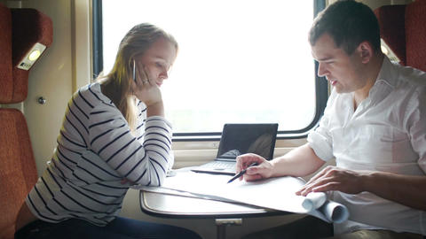 Man And Woman Discussing Drawing During Business T stock footage