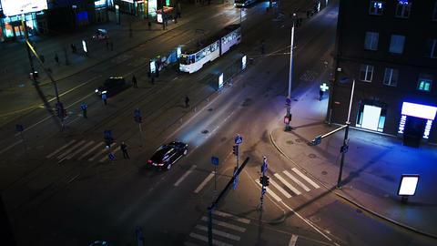 Evening city traffic in Tallin, estonia. Crossroad Stock Video Footage