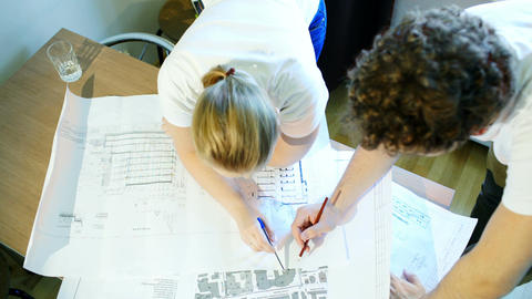 Male and female architects during work with constr Stock Video Footage