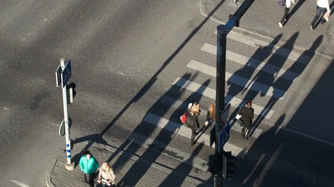 People crossing the street on green light Footage