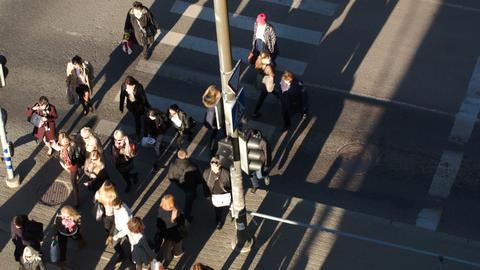 People walking across the road on zebra Stock Video Footage