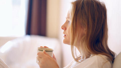Woman having a cup of hot coffee in the morning Stock Video Footage