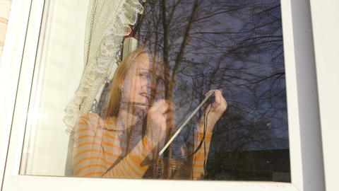 Woman in the window making sketches Live Action