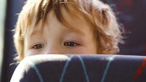 Little boy behind the seat in the bus Footage