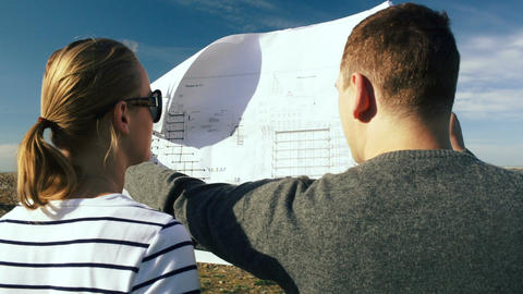 Young people discussing future construction on the Stock Video Footage